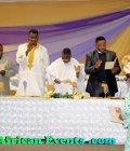 Celebrant Venerable Dr. Nwaigwe and wife receiving prayer blessings